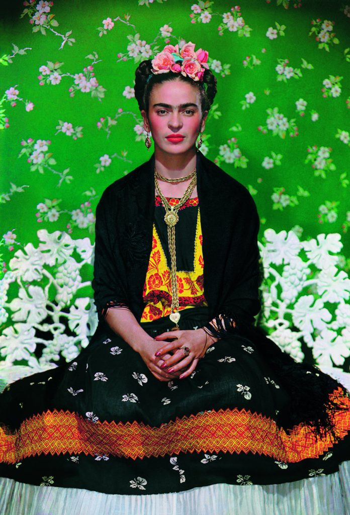 Frida Kahlo on a bench, carbon print, 1938, photo by Nickolas Muray © The Jacques and Natasha Gelman Collection of 20th Century Mexican Art and The Verge,Nickolas Muray Photo Archives